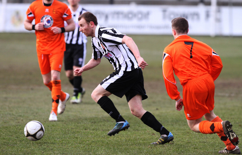 ON THE ROAD TO WEMBLEY: Spennymoor's Steve Capper gets away from Bemerton Heath Harlequins' Danny Young during their FA Vase win on Saturday