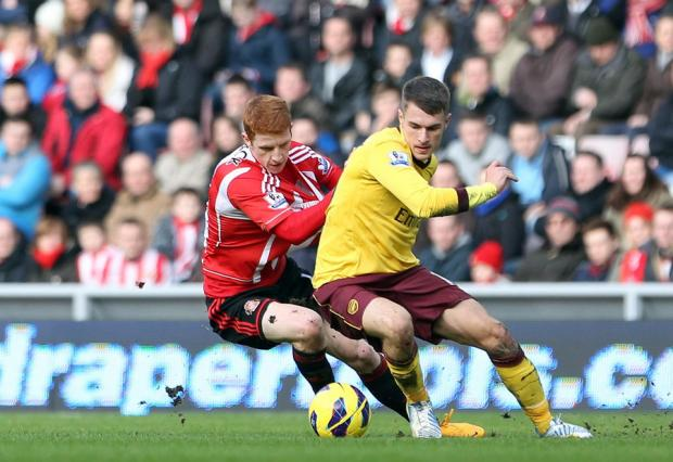 HOME LOSS: Sunderland's Jack Colback closes in on Arsenal's Aaron Ramsey on Saturday