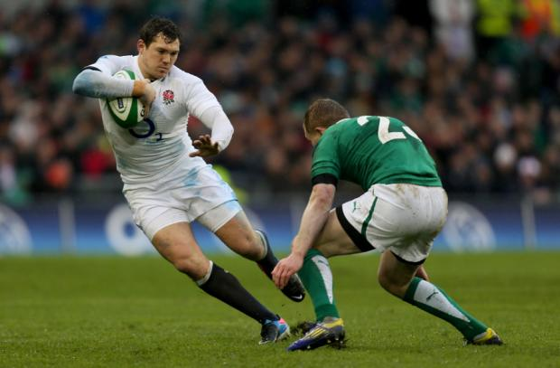 STEPPING OUT: Alex Goode in action against Ireland on Sunday when he gave an imperious display at full back despite the atrocious conditions
