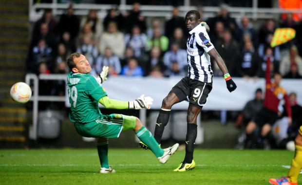 RULED OUT: Papiss Cisse puts the ball beyond