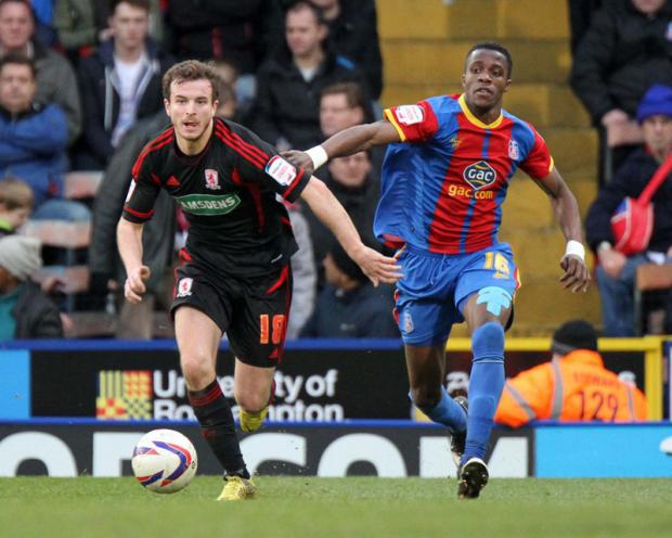 SELHURST HURT: Middlesbrough's Andrew Halliday keeps man of the match Wilfried Zaha at bay at Selhurst Park on Saturday
