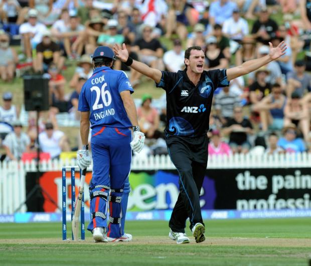 COOK SURVIVES: New Zealand's Kyle Mills, right, fails in an lbw appeal against England's Alastair Cook during the first one-day international at Seddon Park, in Hamilton.