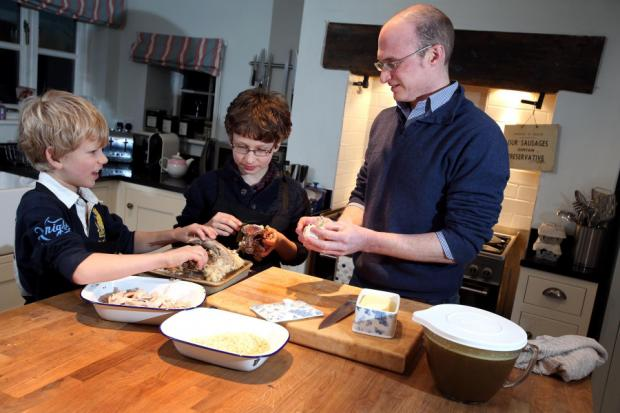 Anthony Sterne making pheasant pie with the helpof stepsons William and Luke