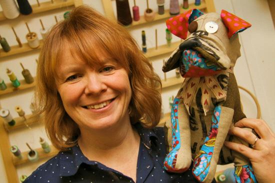 Textiles lecturer Diane Watson with one of her stuffed cloth dogs