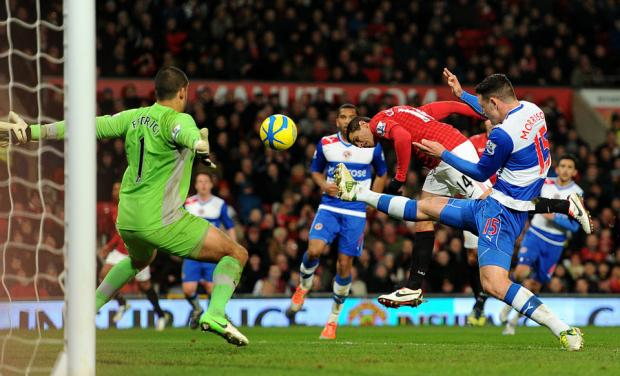 SAFE PROCESS: Javier Hernandez dives to head home Manchester United's second goal at Old Tr