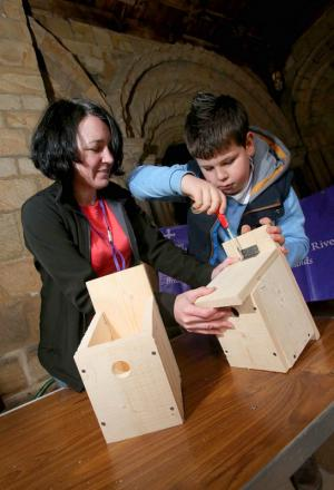 CHEERS: Tracey Dornan, project officer with Heritage Woodlands and Riverbanks, helps Matthew Siddle, nine, build his bird box during the event at Durham Cathedral