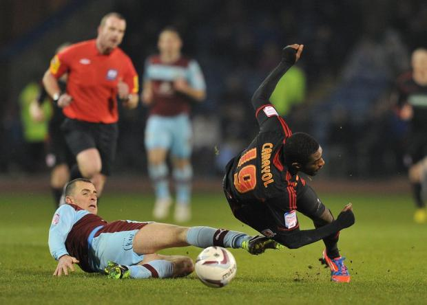 BROUGHT DOWN: Burnley defender Chris McCann makes sure Boro's Mustapha Carayol is stopped as he charged forward at Turf Moor last night