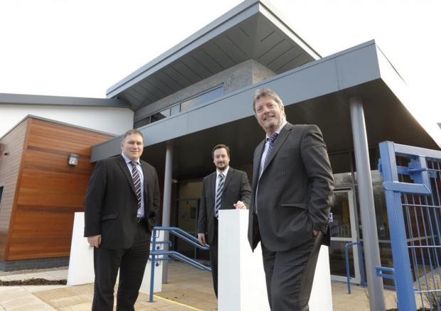 LEGAL BACKING: From left, Alan Ross and Adrian Hicks, from Muckle LLP, with John Phillipson, chief executive at the North-East Autism Society