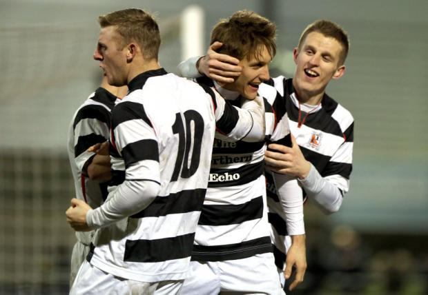 SPOT-KICK: Darlington's Terry Galbraith, second right, and team-mates celebrate his goal from the penalty spot
