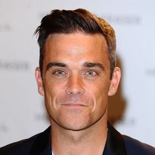 Robbie Williams has previously helped out on the X Factor