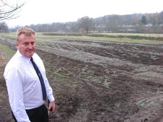 Weardale county councillor John Shuttleworth beside the muddy field