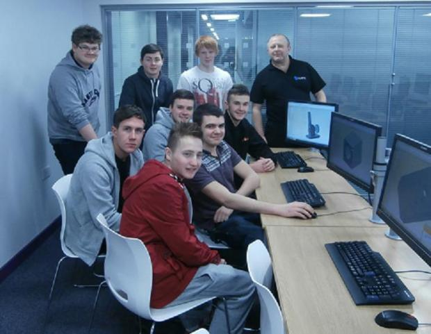 CAD tutor Steve Bloomer with engineering apprentices at South West Durham Training Ltd