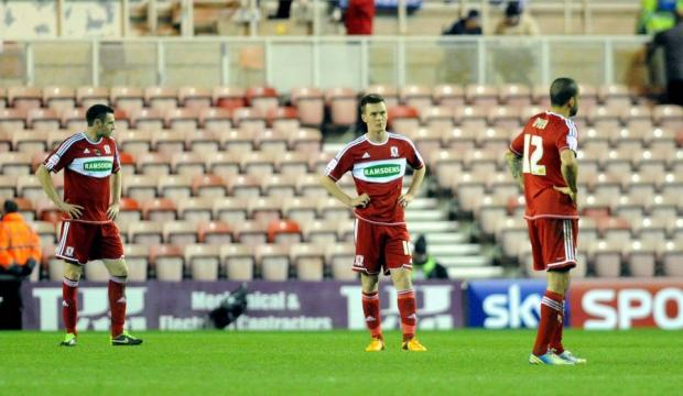 QUESTIONS ASKED: Middlesbrough players look disheartened after conceding two first-half goals against visitors Millwall