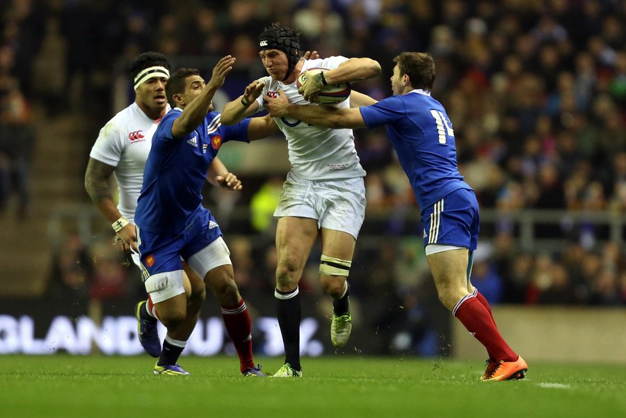 ON THE CHARGE: England No 8 Tom Wood tries to burst between two French defenders