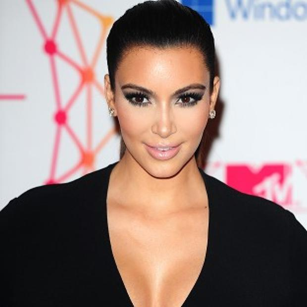 Kim Kardashian is set to give birth in July