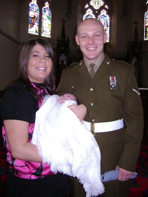 The Northern Echo: HAPPY FAMILY: Lance Corporal David Kenneth Wilson and his fiancee, Michelle Curry, at the christening of their daughter Poppy