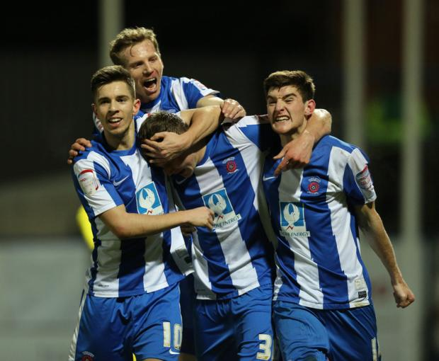 REVIVAL: Charlie Wyke is mobbed by team-mates atfter putting Hartlepool United ahead in last night's 3-0 win over Crewe Alexandra at Victoria Park