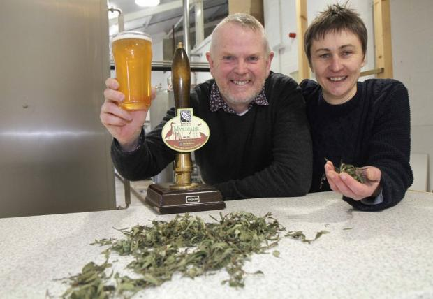 RAISING A GLASS: John Lewis and Jane Blackman, of the Treboom Brewery, with a pint of Myricale