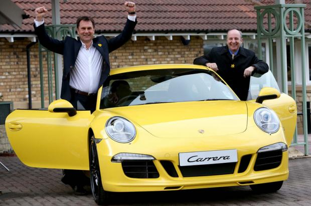 STAR PRIZE: Event organisers Ian Watson, left, and Graham Wylie with the Boxster