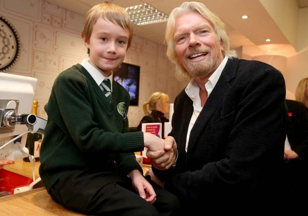 STARTING YOUNG: Sir Richard Branson talks to eight-yearold Dylan Knox, from Blyth, during his brief visit to the Virgin Money branch in Newcastle