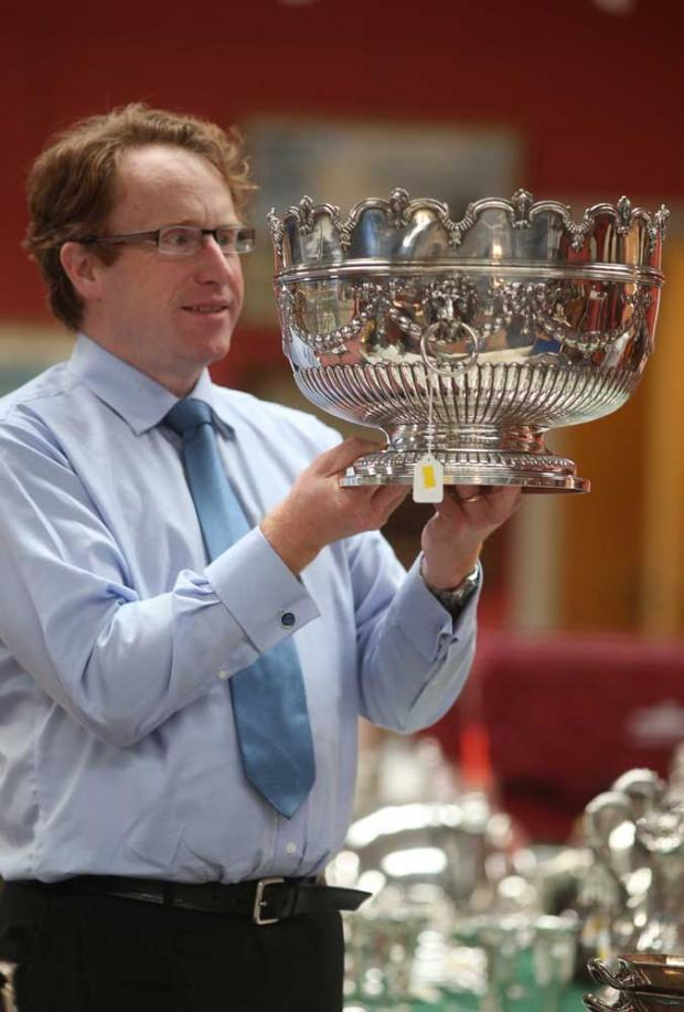 Julian Thomson of Anderson and Garland with silver punch bowl