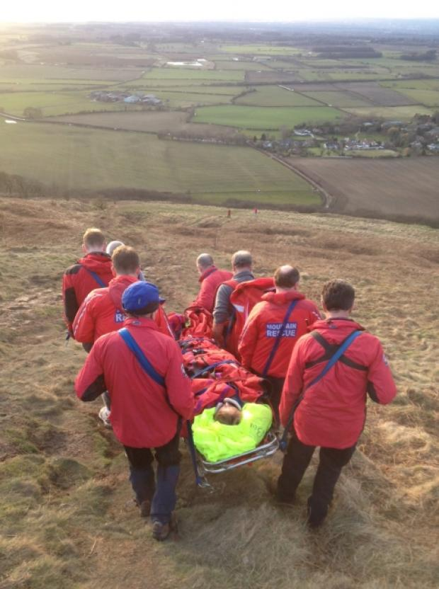 Volunteers from Cleveland Mountain Rescue Team carry an injured woman down Roseberry Topping