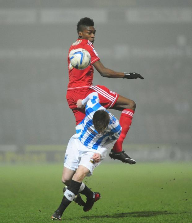 HIGH BALL: Boro's Sammy Ameobi vies for possession with Huddersfield's Paul Dixon