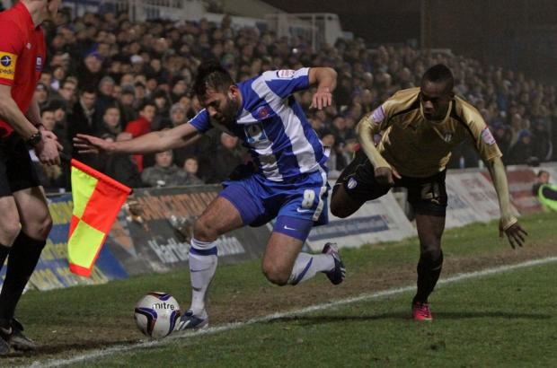 DRAWING A BLANK: Hartlepool United's Simon Walton is pushed out of play by Colchester United's Gavin Massey during last night's 0-0 draw at Victoria Park