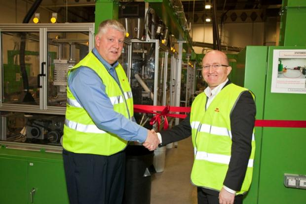 3M senior vice-president Chris Holmes, right, congratulates site manager Dave Watson on the completion of the new production line