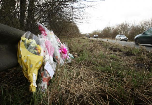 ROADSIDE TRIBUTES: Flowers left by the side of the A66 near Darlington after the fatal accident