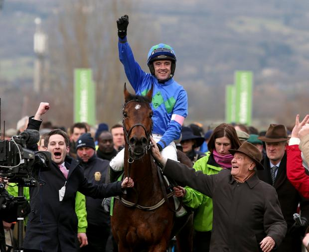 The Northern Echo: Hurricane Fly ridden by jockey Ruby Walsh after winning the Stan James Champion Hurdle Challenge Trophy on the opening day of the Festival – one of three winners for the Irishman