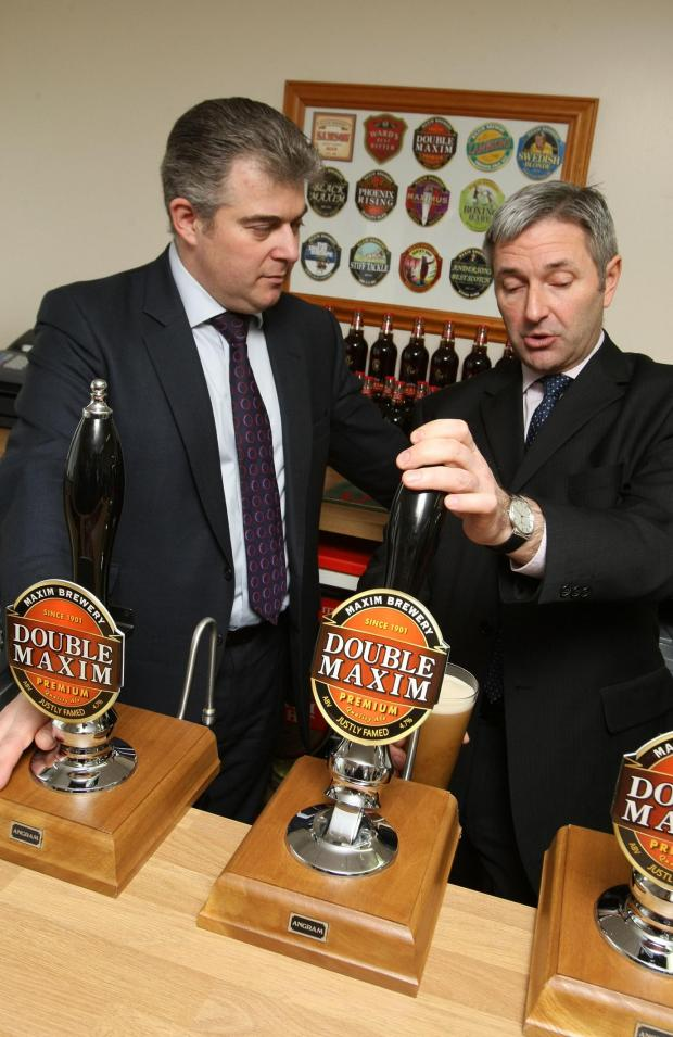 Mark Anderson, managing director of Maxim Brewery, pulls a pint for Community Pubs Minister Brandon Lewis