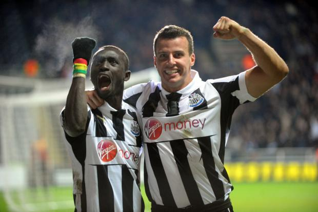 JOB DONE: Papiss Cisse, Newcastle's late-match winner, celebrates victory with Steven Taylor