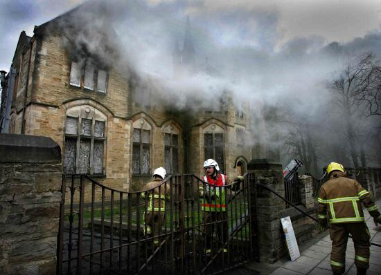 Firefighters attend the scene of a fire at the old Bishop Auckland Grammar School, in March 2007