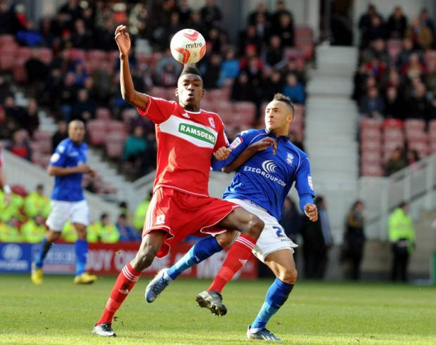 The Northern Echo: BALANCING ACT: Middlesbrough loanee Sammy Ameobi appears to balance the ball on his hair as he shields the ball from Birmingham's Nathan Redmond