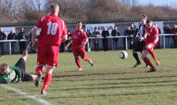 MATCH-WINNER: Striker Steven Johnson slots home in the 71st minute to give Darlington the points at Ashington