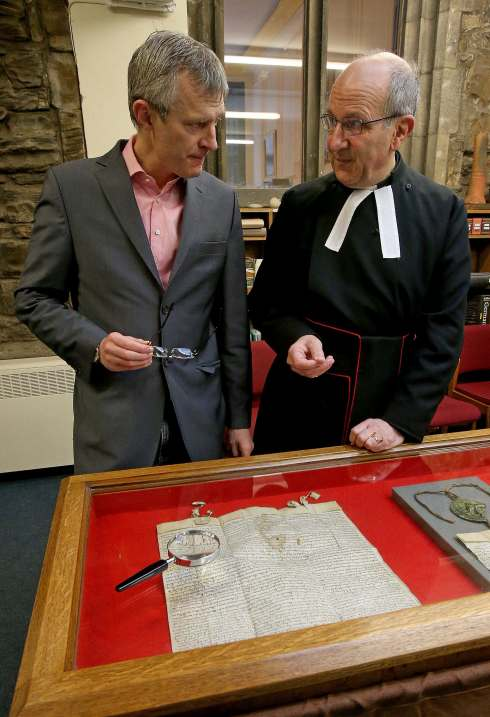 Broadcaster and Open Treasure Champion Jeremy Vine and the Very Reverend Michael Sadgrove, Dean of Durham take a closer look at one of the Cathedral's copies of the Magna Carta during Open Door - Open Treasure event.