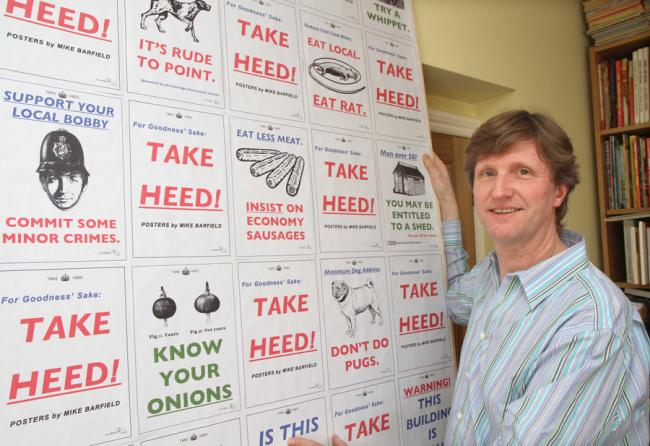 Private Eye cartoonist Mike Barfield from Helperby with some of his posters which feature in his exhibition