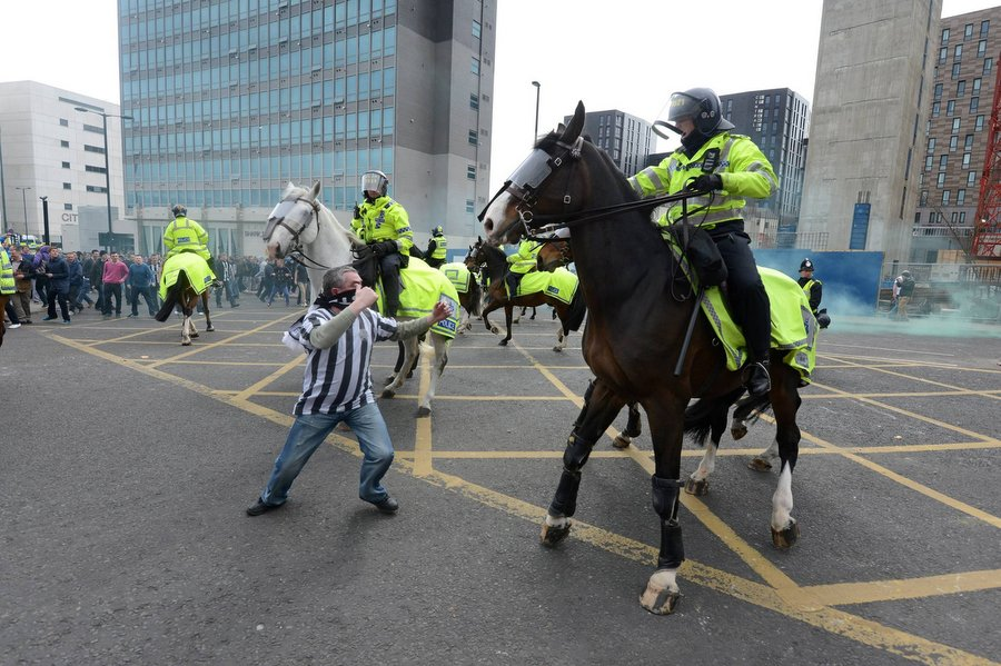 Newcastle fan Barry Rogerson, 45, squares up to a police horse before punching it