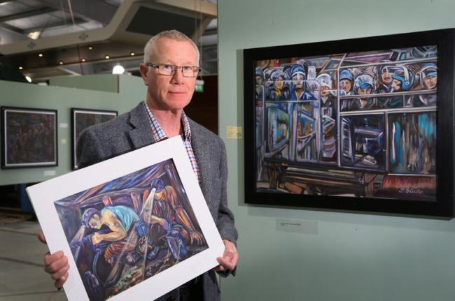 PIT PICTURES: Derek Slater pictured with some of his paintings