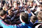 Darlington players celebrate with fans at becoming champions of the Northern League
