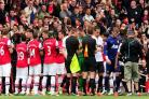 CHAMPIONS TOASTED: Arsenal provide a guard of honour as champions Manchester United enter the pitch