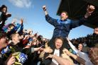 Martin Gray celebrates with fans after his side were crowned Northern League champions