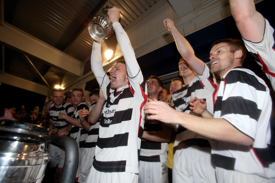 JUST CHAMPION: Darlington's Steven Johnson lifts the Northern League trophy after his side beat Guisborough Town 3-0 last night