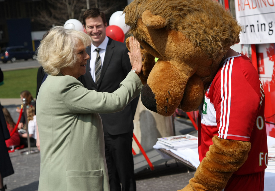 The Duchess of Cornwall gives Roary the Lion a high-five during a visit to Middlesbrough