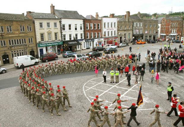 RECENTLY RETURNED: Members of 150 Provost Company, 3rd Regiment Royal Military Police, marching through Richmond.