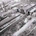 COOKING ON GAS: Bishop Auckland gasworks in 1955, from the roof of the three million cubic foot gasholder – last week's distinctive scrubber tower is the second from the left. The street running diagonally from the centre left of the picture is Tindal