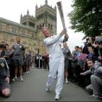 Paul Collingwood used the Olympic torch as a cricket bat as he set off from Durham Cathedral