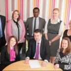 Niall Head-Rapson, seated centre, with McDaniels' IP team