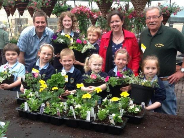 Front row, left to right, James Elliott, seven, Mia Forden, seven, Noah Stand, six, Neve Cooper, five, Kate Neasham, six, Maisey Metcalfe, five. Back row, Brian Bradbury from Sam Turner and Sons, Eliza Wilkinson, 11, Joshua Swain, ten, teacher Emma Henry